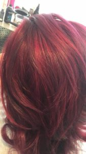 Stunning shoulder length dark red hair close up