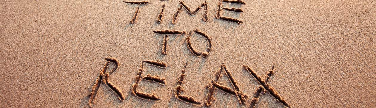 Time to Relax written in sand