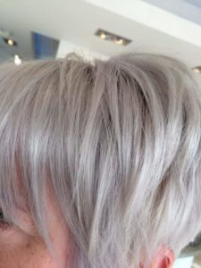 Fringe closeup on short blonde hair