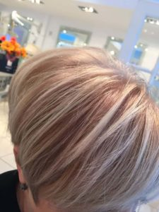 Short blonde hairstyle with mild red highlights
