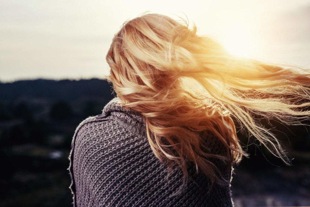 Lomg haired blonde woman on winter scene