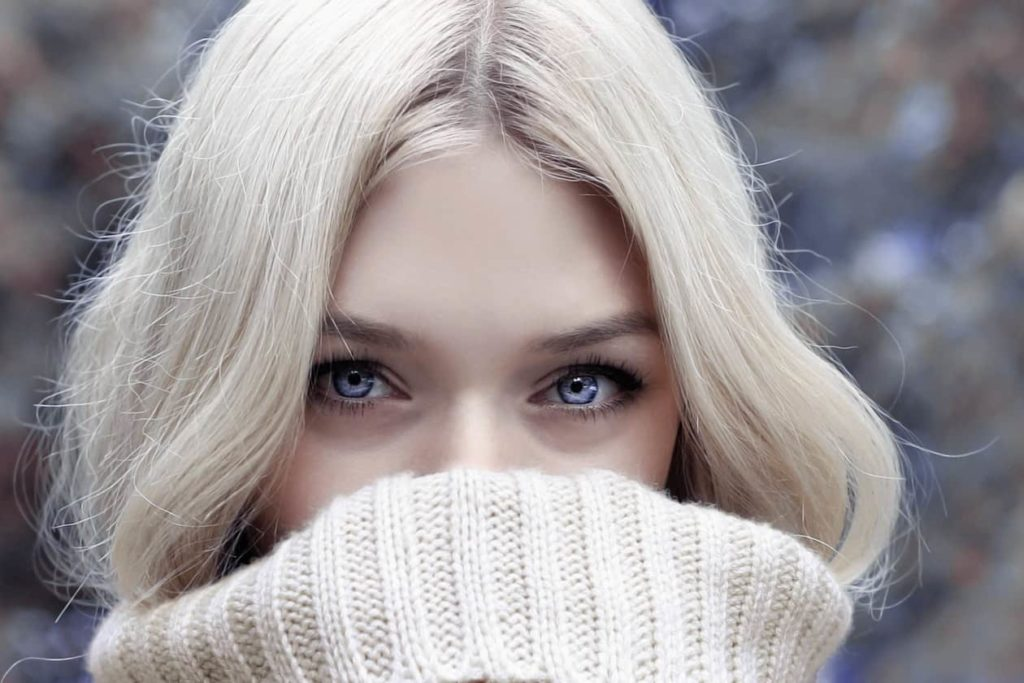 Blonde haired woman in roll neck jumper