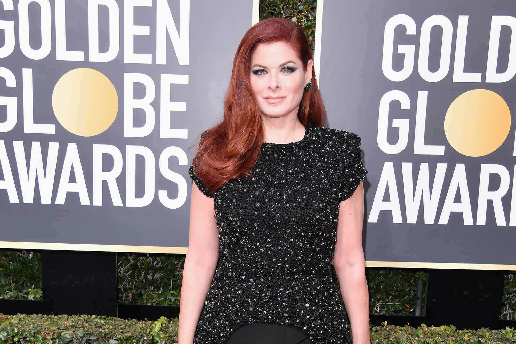 Debra Messing shows off long red hair at Golden Globe awards