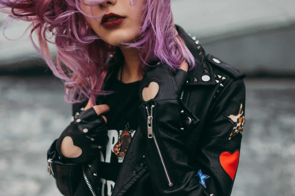 Leather clad woman with coloured purple hair