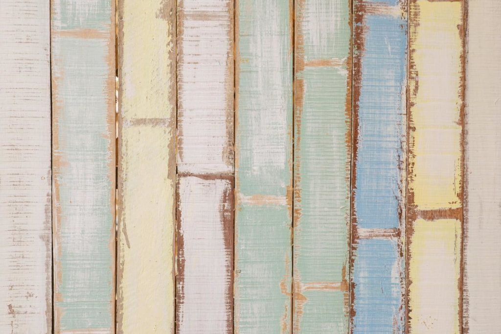 Faded pastel colours on wooden panels
